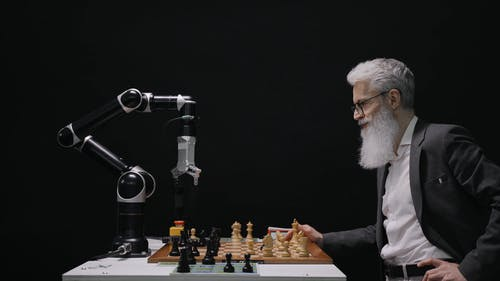 Man Playing Chess With A Robot