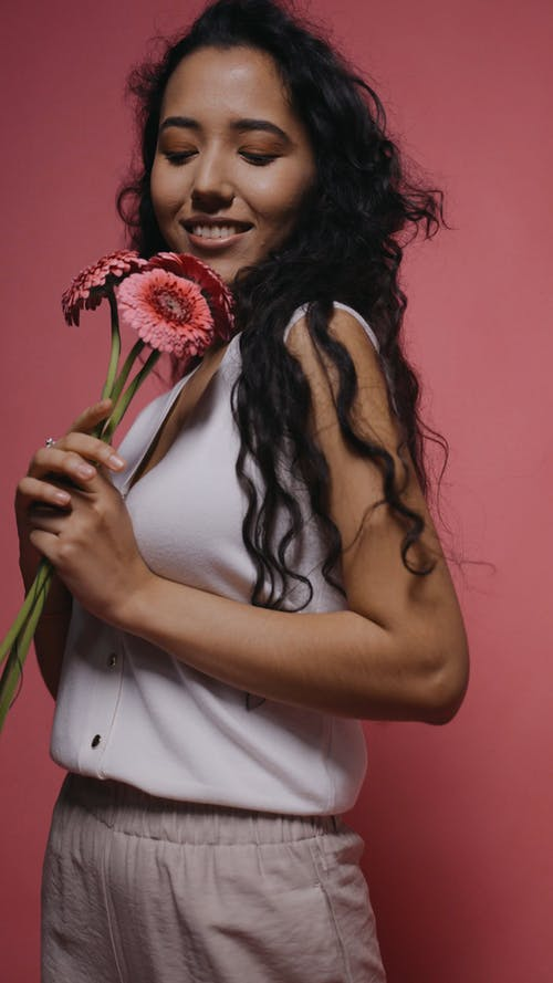 A Woman Posing with Flowers