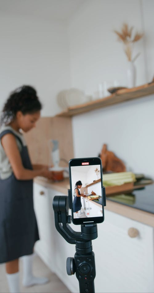 Woman Recording Herself Cooking
