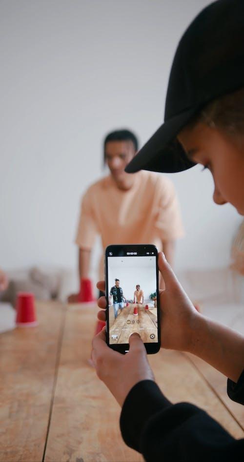 Woman Recording Her Friends Having Fun