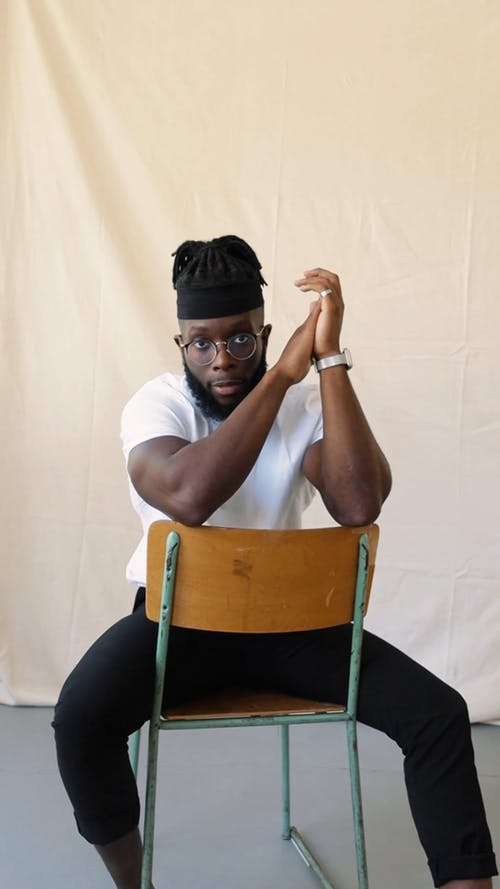A Man Posing on a Chair