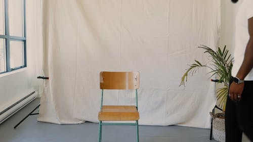 A Man Walking Away after Sitting on a Chair