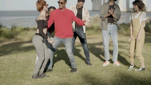 People Enjoying Dancing Together