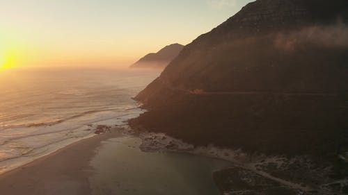 Drone Footage of a Sunrise at a Beach