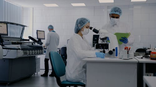A Woman Using Microscope