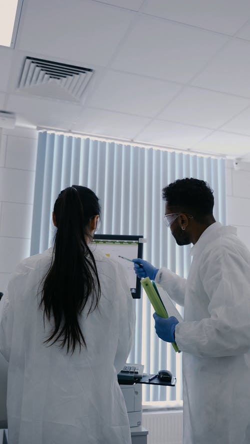 People in the Laboratory Looking at the Monitor of a Computer
