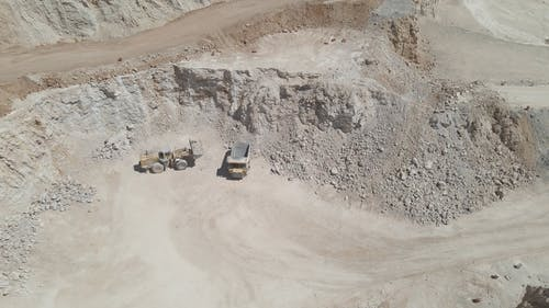 Aerial Video of Trucks on a Mining Site