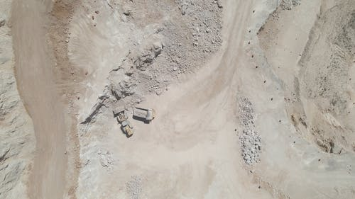 Drone Footage of  Front Loader and Dump Trucks