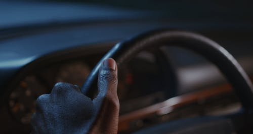 A Person's Hands on a Steering Wheel