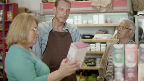 A Store Clerk Talking to an Elderly Couple