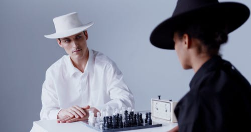 A Man and a Woman Playing Chess