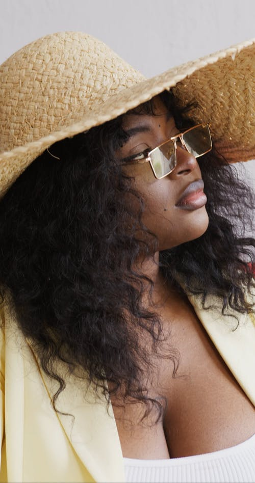 Woman Wearing Eyeglasses and Beach Hat