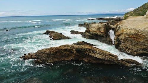 Waves Crashing on Rocky Coast