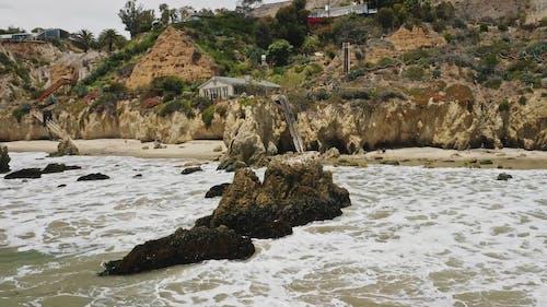 Natural Rocks Formation In The Coastline