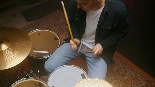 A Man Playing Drums
