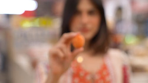 Close Up of a Person Holding an Apricot Fruit