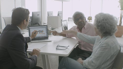 Elderly Man Pointing at a Laptop Screen