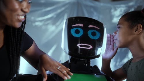Video of Girl Whispering on a Robot