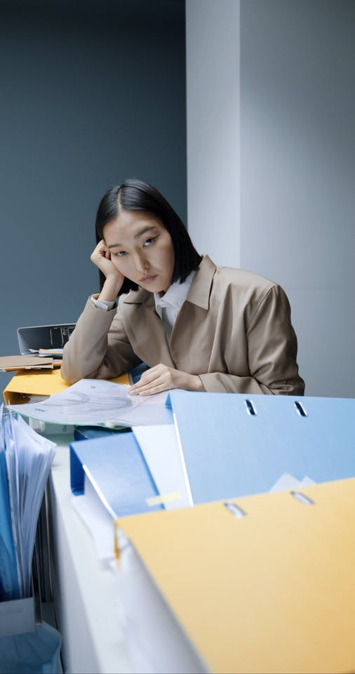 A Woman S Desk Filled With Documents