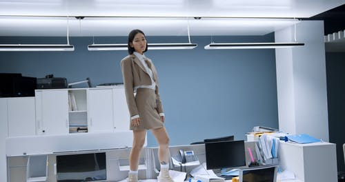 Woman Standing on an Office Table