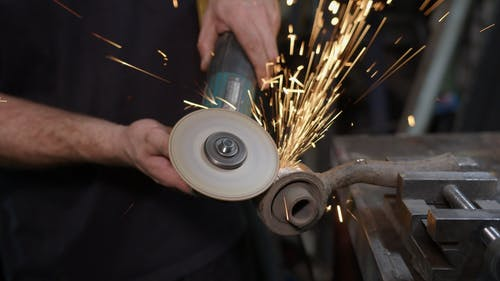 Person using Angle Grinder
