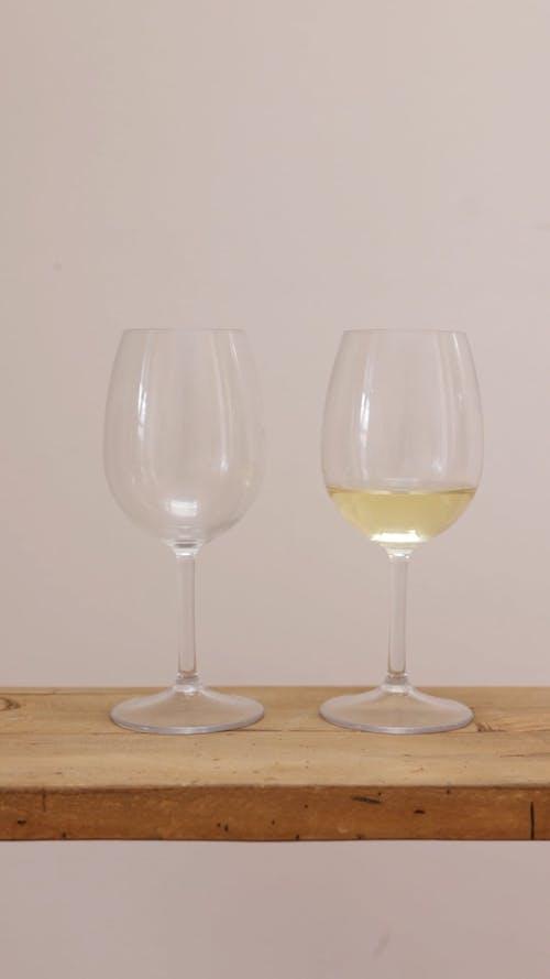 A Person Pouring White Wine in a Glass