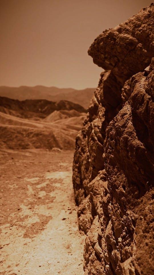 An Astronaut Walking In A Desert