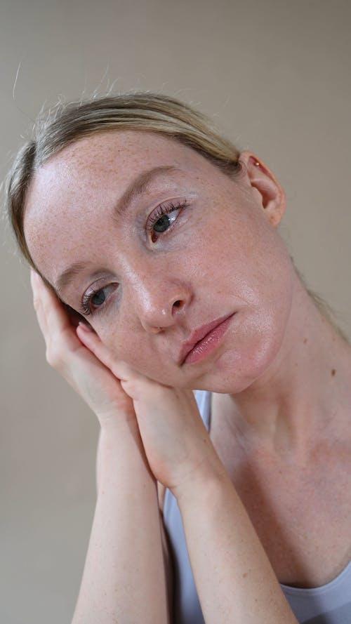 A Woman with a Sad Face