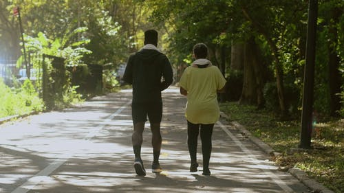 A Man and a Woman Walking in a Park
