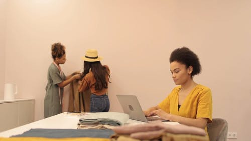 Woman with Afro Hair Using Laptop at the Office