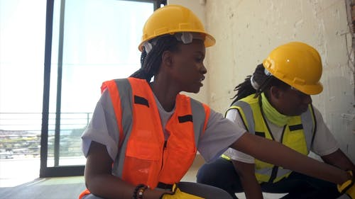 Women Talking at a Construction Site