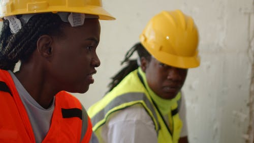 Close Up of Women Talking at a Construction Site