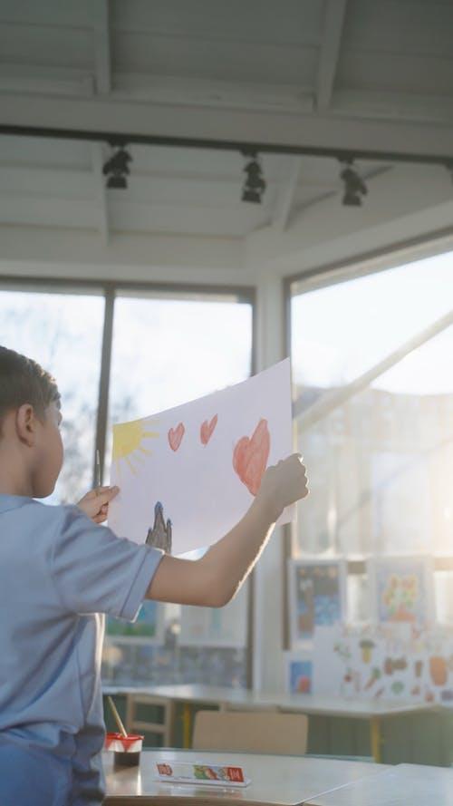 Boy Looking at his Painting