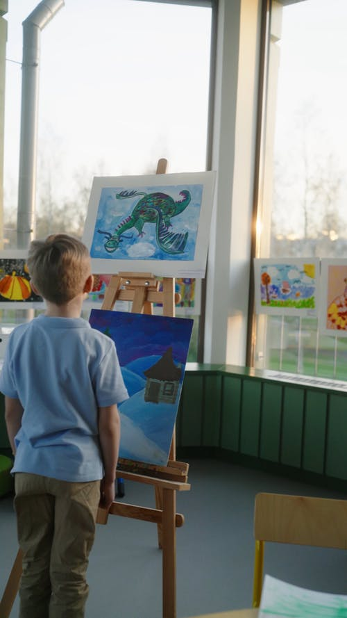 Boy Looking at the Painting