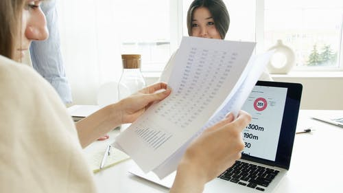 A Woman Holding Paper Reports