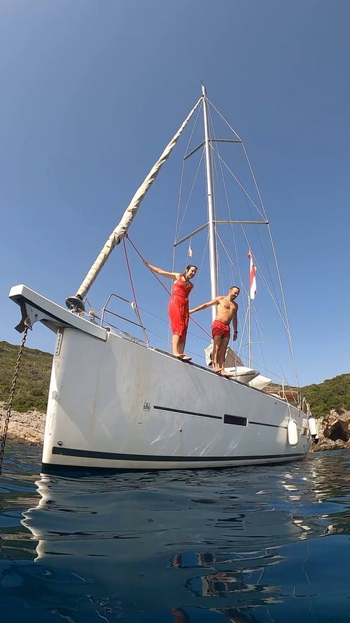 A Man and Woman Jumping from a Boat