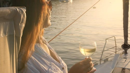 A Woman on a Boat Holding a Glass of Champagne