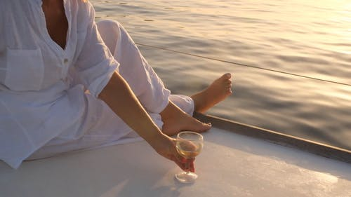 A Woman Sitting on Yacht