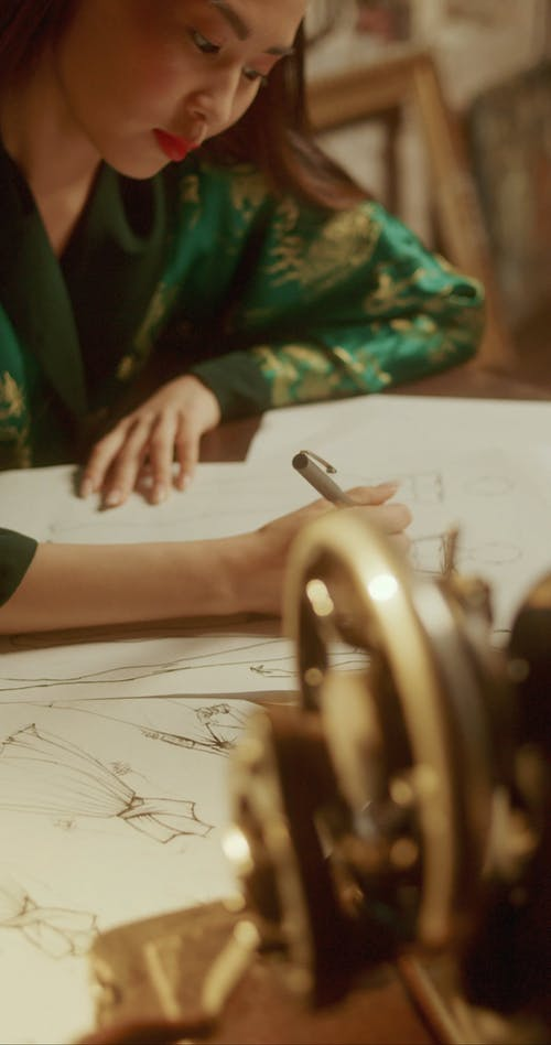 A Woman Drawing Clothing Designs