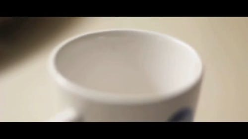 Filling a Cup With Water in Slow Motion