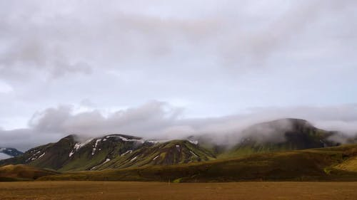 Time Lapse Video Of Clouds Over Mountains