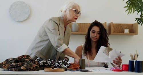 Elderly Woman Talking to a Woman
