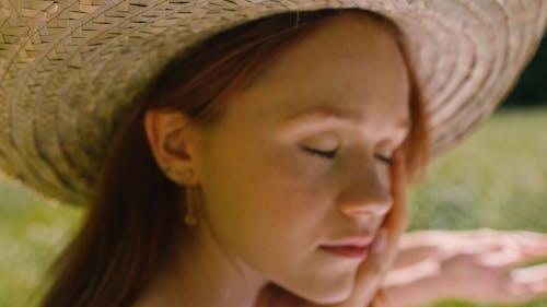 Beautiful Woman Wearing a Sun Hat