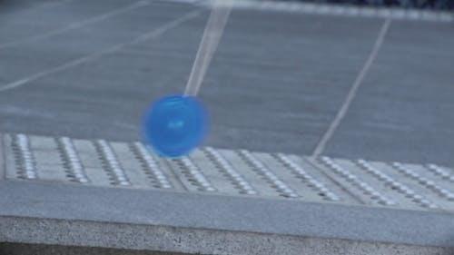Playing Yo-Yo on the Street