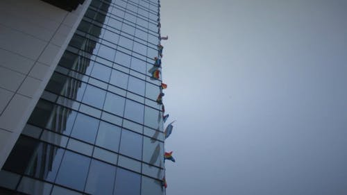 Flags On High Rise