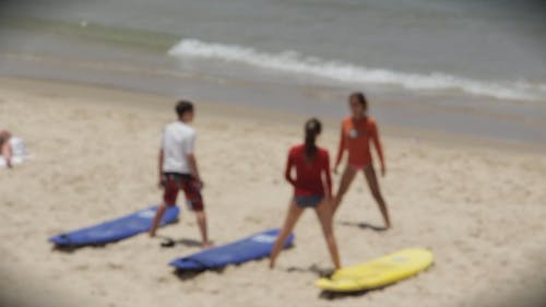 People Stretching At The Beach