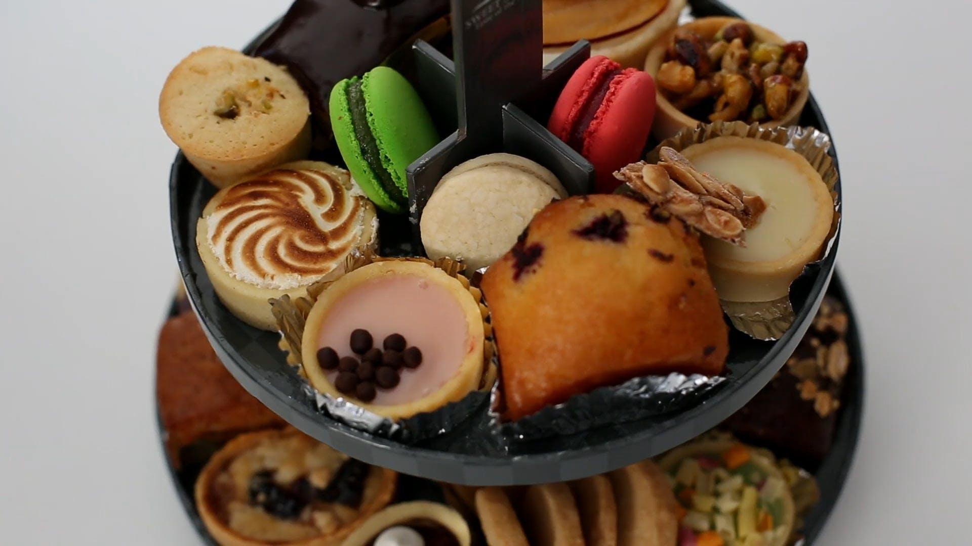 People Grabbing Different Types of Dessert