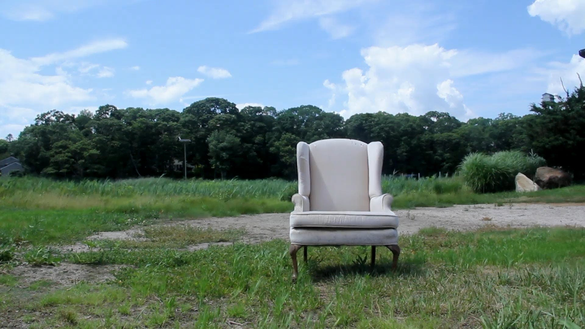 Chair In the Middle of an Open Field