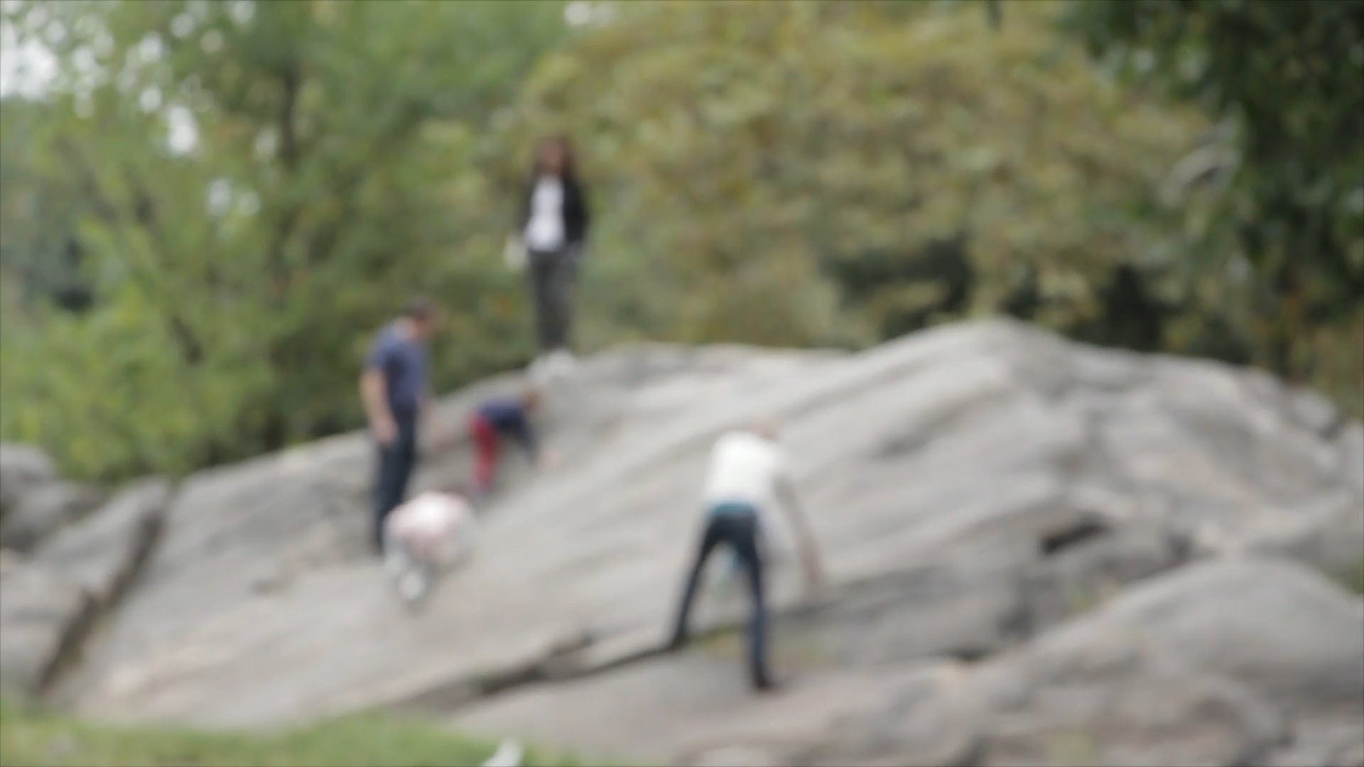 Blurred Video Of Family Climbing Rock