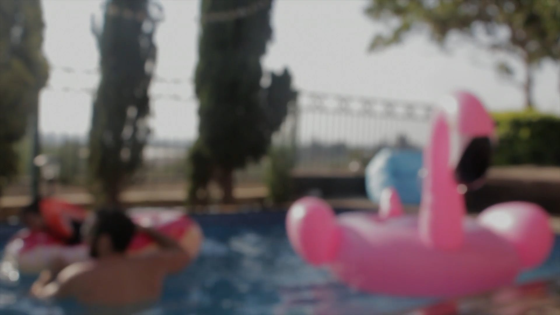 Blurry Video Of People In A Pool